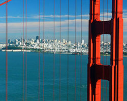 A View of San Francisco through the spires of the Golden Gate Bridge from the Marin Headlands.